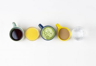 coffee-tea-and-other-drinks-in-colorful-cups-on-a-white-background-top-view